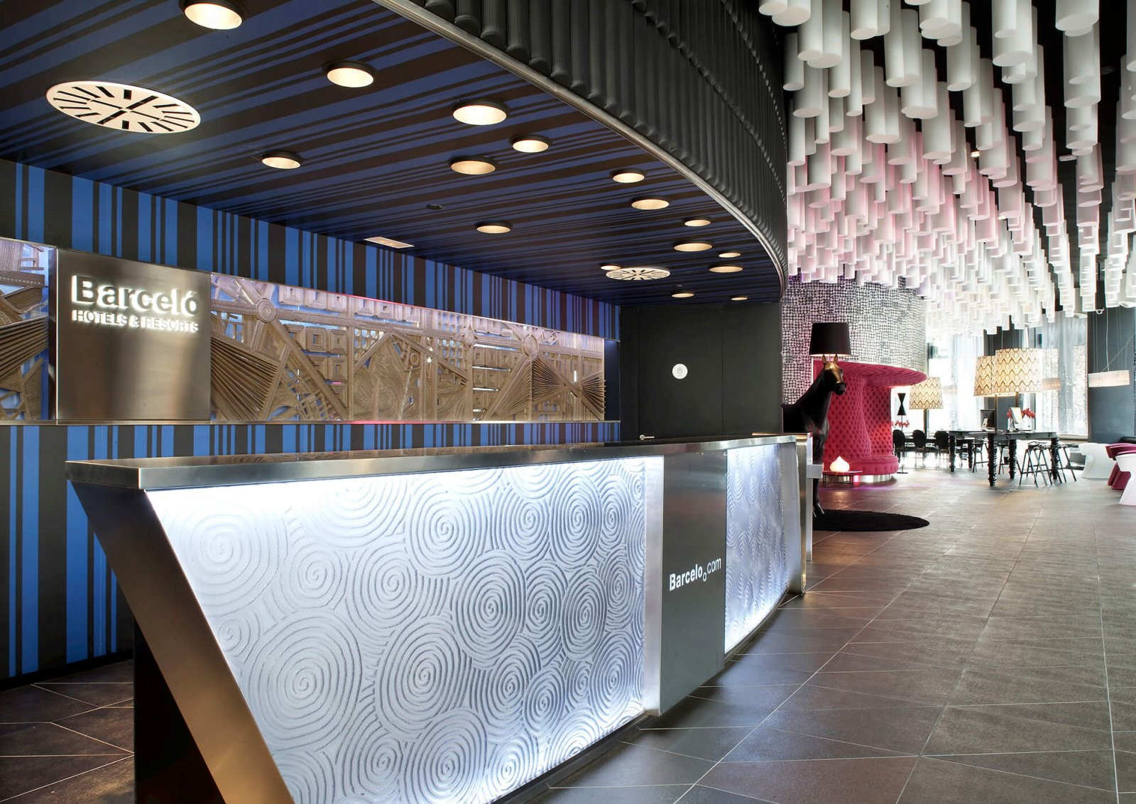 Detail view of the front desk of the raval hotel and the common area, where its interesting ceiling stands out