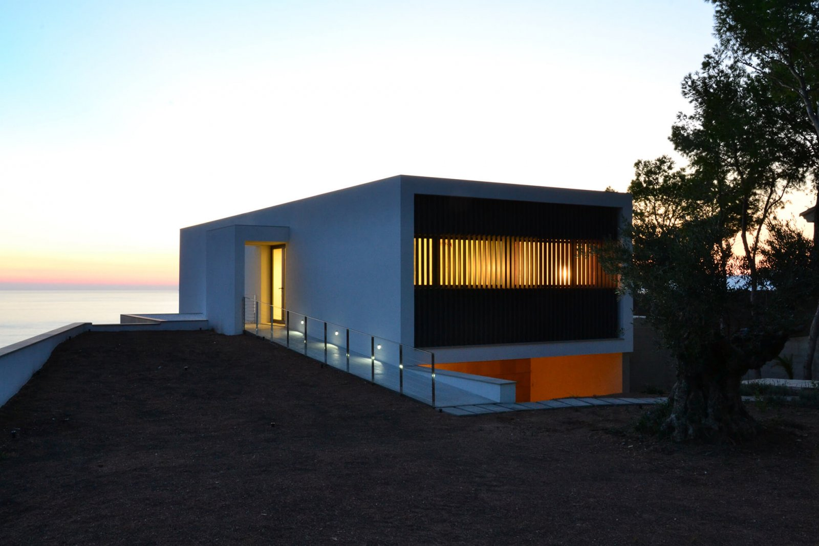 View of the facade of the Maioris house at sunset