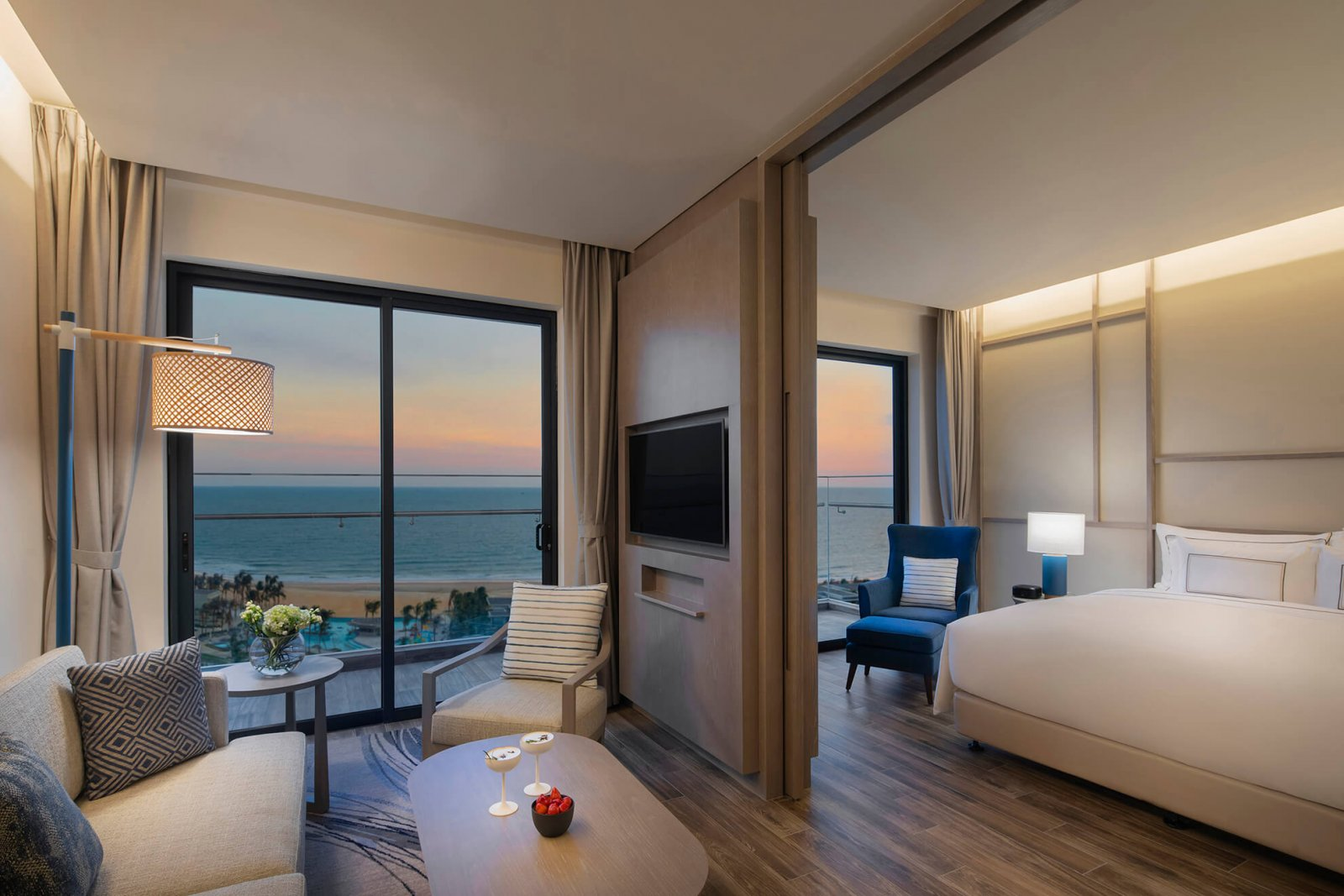 Interior view of the room with night area, day area, and balcony overlooking the beach at Melia Ho Tram