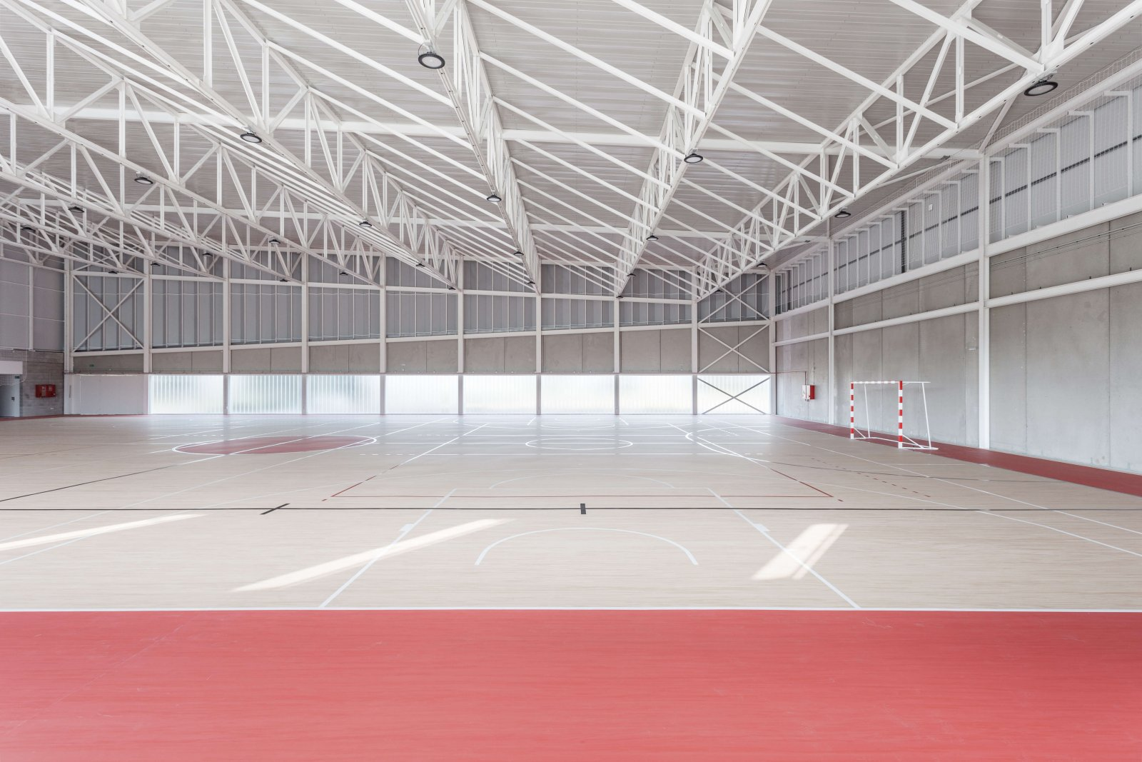 Another view of the sports court with parquet floors marked for basketball and football of the pavilion son ferragut