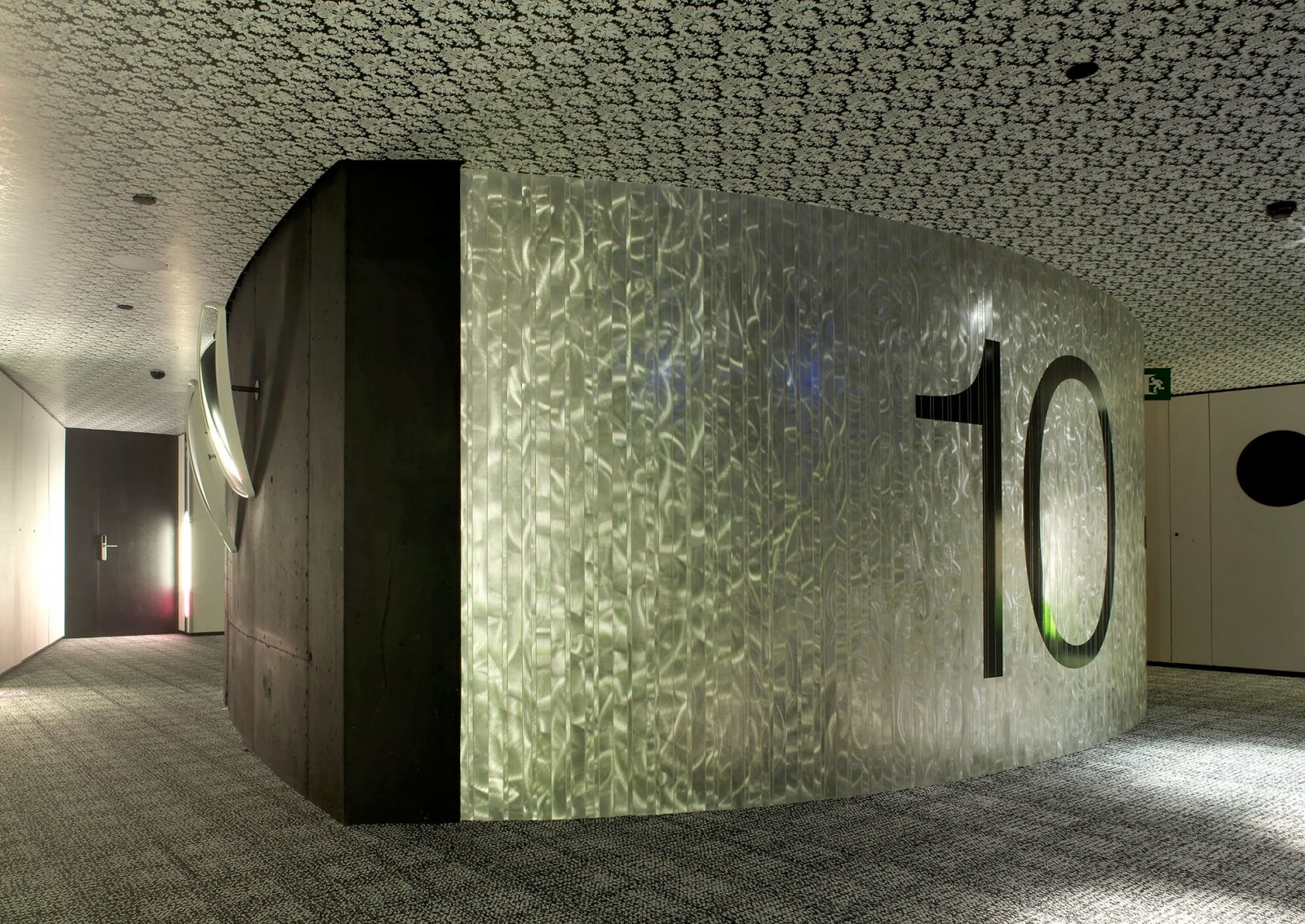 Detail view of a hallway with modern patterned ceiling, floor and wall of the hotel raval