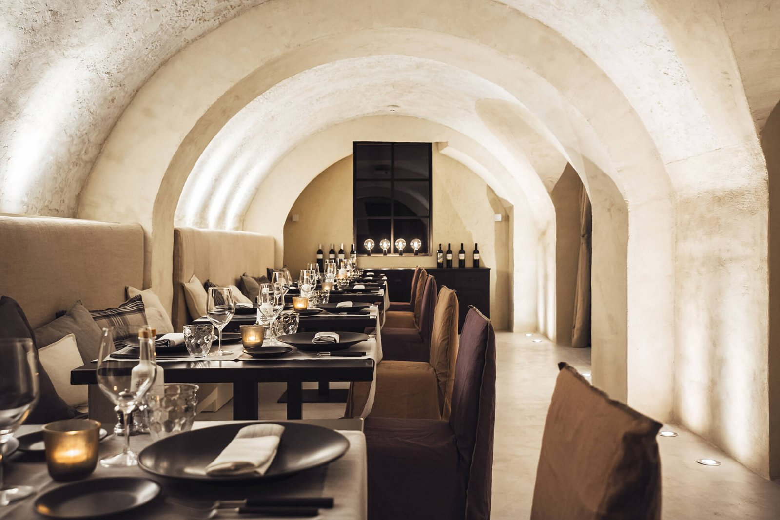 Detail view of the set tables in the restaurant and arched cream ceilings