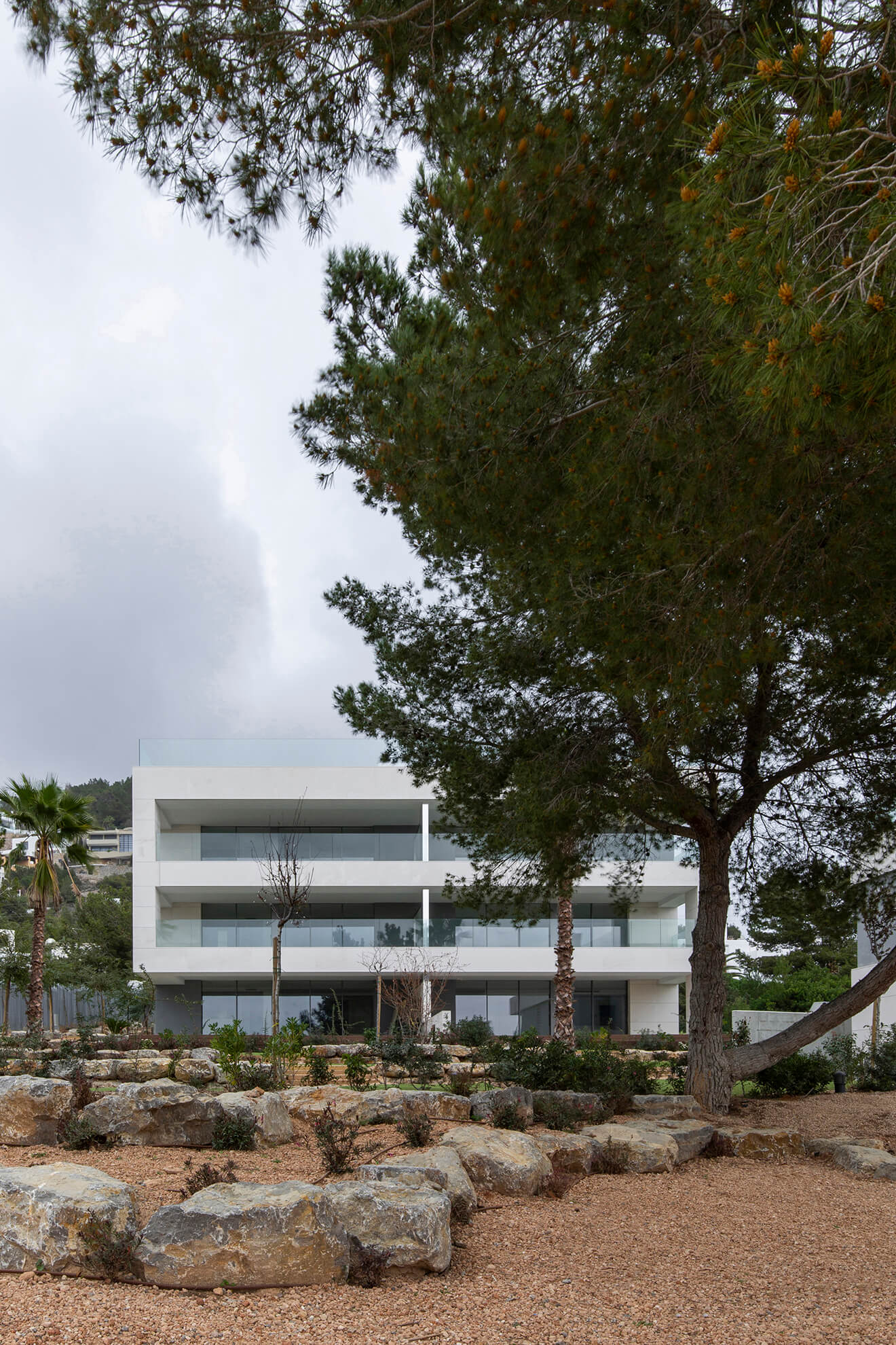 Another view of the facade of one of the houses of the Talamanca residential II with a garden and trees