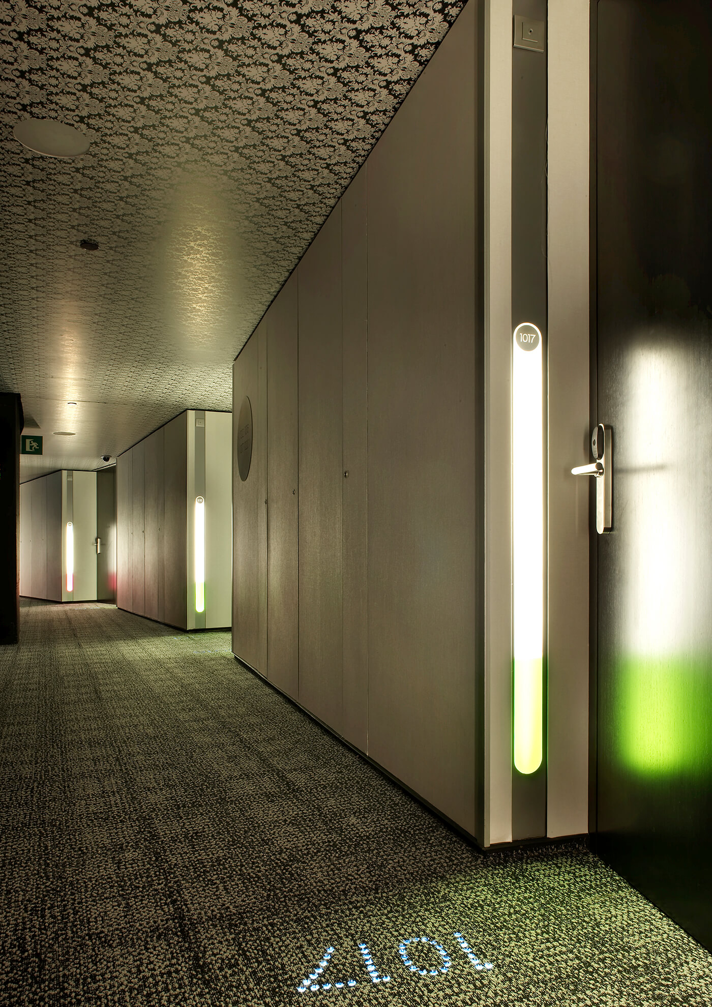 Another detail view of a hallway with modern patterned ceiling and wall of the hotel raval