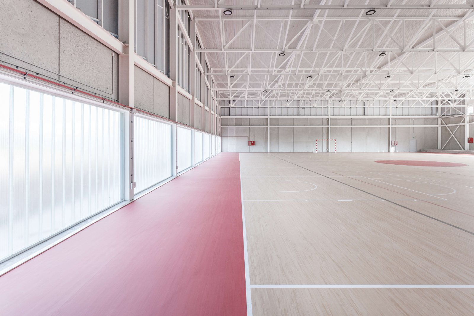 Another view of the sports court focusing on the opaque windows and the area that limits the court