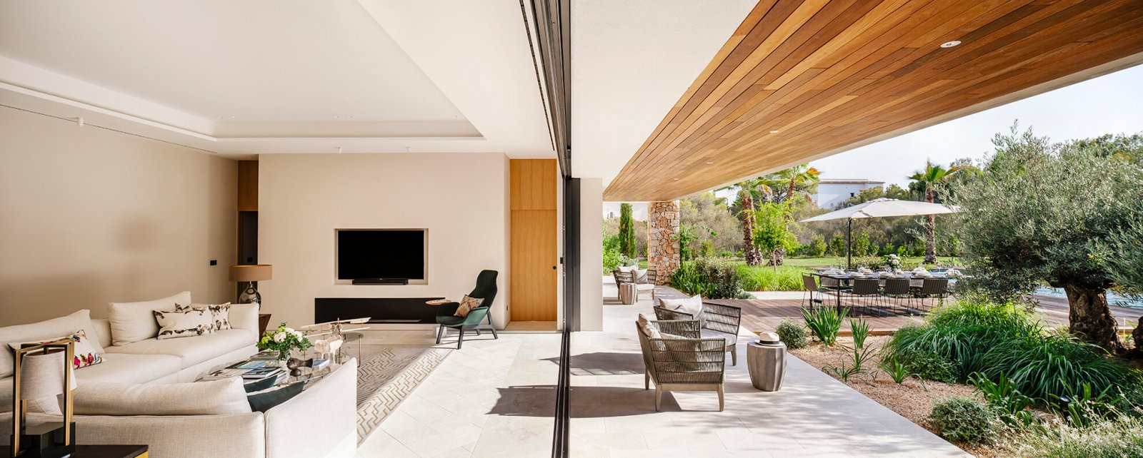 View of the living room joined through a large open sliding glass doors to the chill-out and garden of the Sol de Mallorca house